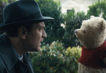 A grown-up Christopher Robin meets his childhood playmate, Pooh, once more.